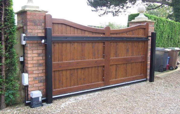 Wooden sliding gate with curved top